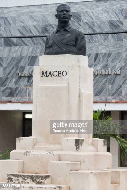 Antonio Maceo bust in the historic district of the city Black bust of a moustached man on a white pedestal
