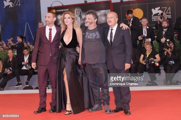 Antonio Manetti Claudia Gerini Marco Manetti and Carlo Buccirosso walk the red carpet ahead of the 'Ammore E Malavita' screening during the 74th...