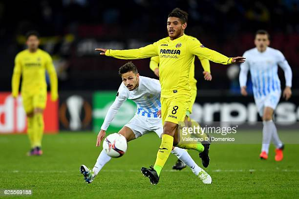 Antonio Marchesano of FC Zurich competes for the ball with Jonathan Dos Santos of Villareal during the UEFA Europa League match between FC Zurich and...