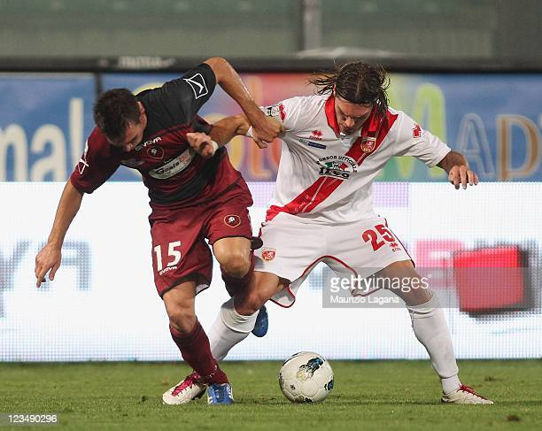 Antonio Marino of Reggina competes for the ball with Federico Gerardi of Grosseto during the Serie B match between Reggina Calcio and US Grosseto FC...