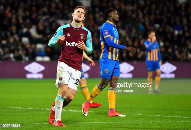 Antonio Martinez Lopez of West Ham United reacts after a miss during The Emirates FA Cup Third Round Replay match between West Ham United and...