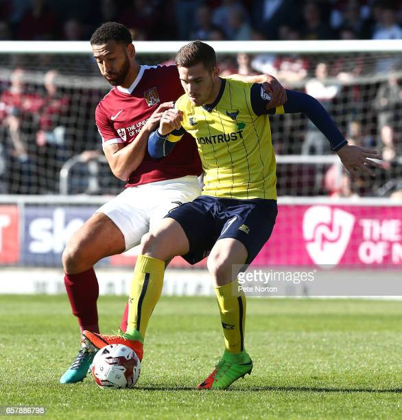 Antonio Martinez of Oxford United controls the ball under pressure from Lewin Nyatanga of Northampton Town during the Sky Bet League One match...