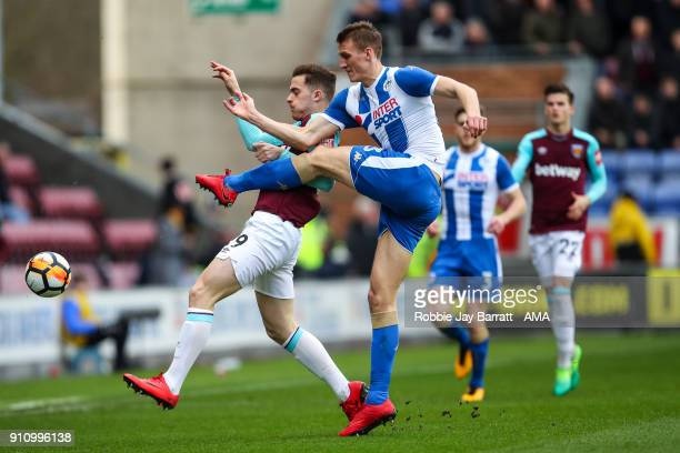 Antonio Martinez of West Ham United and Dan Burn of Wigan Athletic during the The Emirates FA Cup Fourth Round match between Wigan Athletic and West...
