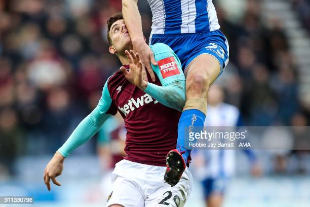 Antonio Martinez of West Ham United gets climbed on by Dan Burn of Wigan Athletic during the The Emirates FA Cup Fourth Round match between Wigan...