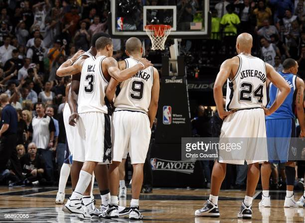 Antonio McDyess George Hill Tony Parker and Richard Jefferson of the San Antonio Spurs huddle on the court in Game Four of the Western Conference...
