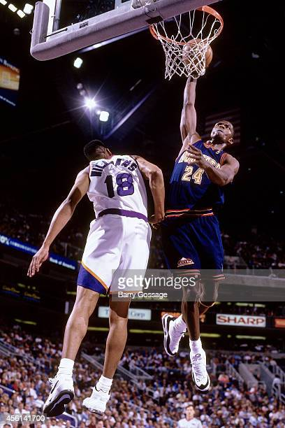 Antonio McDyess of the Denver Nuggets drives to the basket against the Phoenix Suns during the 1997 season at the America West Arena in Phoenix...