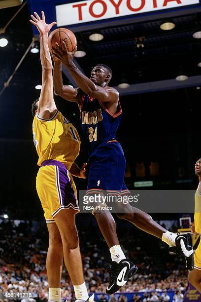 Antonio McDyess of the Denver Nuggets drives to the basket against the Los Angeles Lakers during the 1996 season at The Forum in Inglewood California...