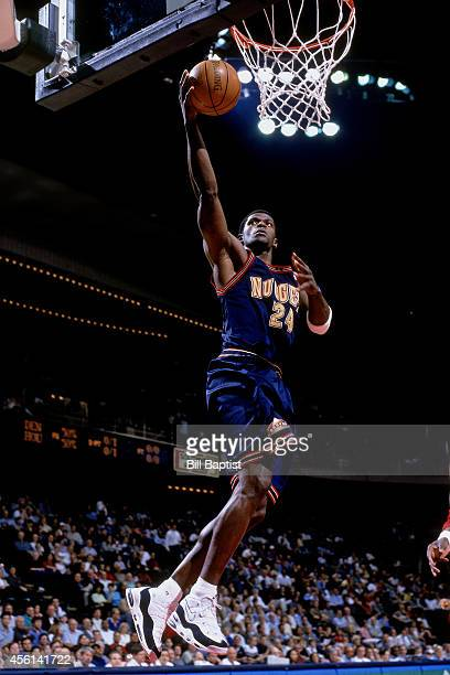 Antonio McDyess of the Denver Nuggets drives to the basket against the Houston Rockets during the 2000 season at the Compaq Center in Houston Texas...