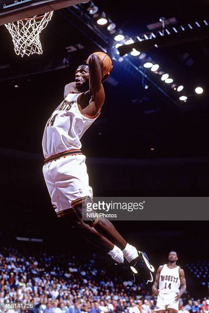 Antonio McDyess of the Denver Nuggets drives to the basket against the Washington Bullets during the 1996 season at the Pepsi Center in Denver...