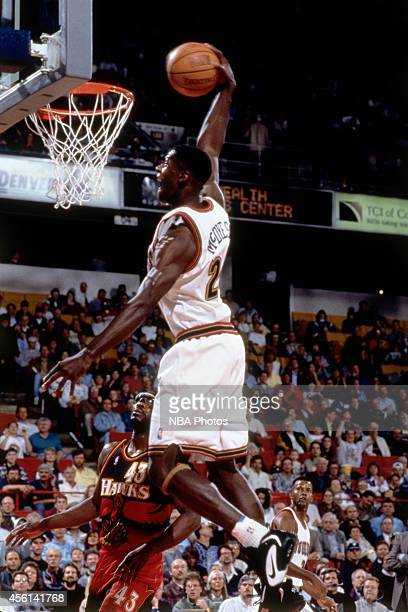 Antonio McDyess of the Denver Nuggets drives to the basket against the Atlanta Hawks during the 1996 season at the Pepsi Center in Denver Colorado...