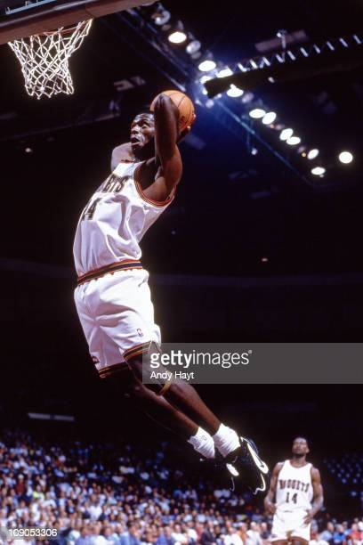 Antonio McDyess of the Denver Nuggets dunks against the Golden State Warriors in a pre season game on October 25 1995 at The Oracle Arena in Oakland...