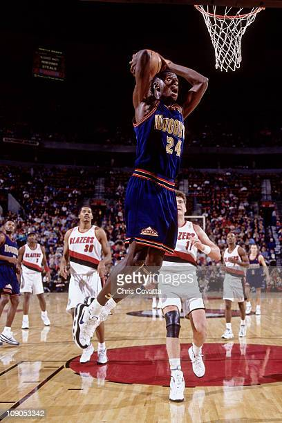 Antonio McDyess of the Denver Nuggets dunks against The Portland Trail Blazers in a game on November 23 1996 at The Rose Garden in Portland Oregon...