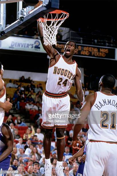 Antonio McDyess of the Denver Nuggets dunks against the Utah Jazz in a game on March 23 1997 at the McNichols Sports Arena in Denver Colorado NOTE TO...