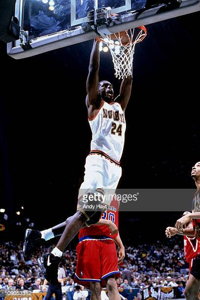 Antonio McDyess of the Denver Nuggets dunks against the Washington Bullets during a game in 1996 at the McNichols Sports Arena in Denver Colorado...