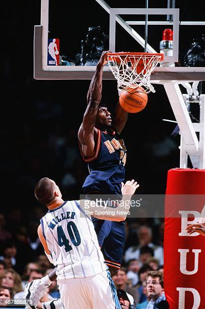 Antonio McDyess of the Denver Nuggets dunks during the game against the Charlotte Hornets on December 10 1999 at Charlotte Coliseum in Charlotte...