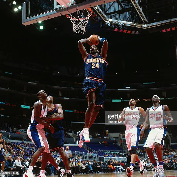 Antonio McDyess of the Denver Nuggets dunks the ball against the Los Angeles Clippers on January 10 2001 at Staples Center in Los Angeles CA NOTE TO...