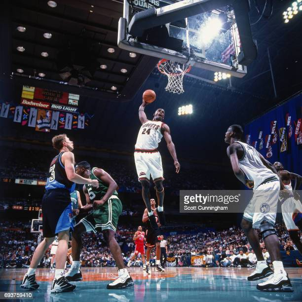Antonio McDyess of the Denver Nuggets dunks the ball during the game during the 1996 Rookie Challenge played on February 10 1996 at the Alamodome in...