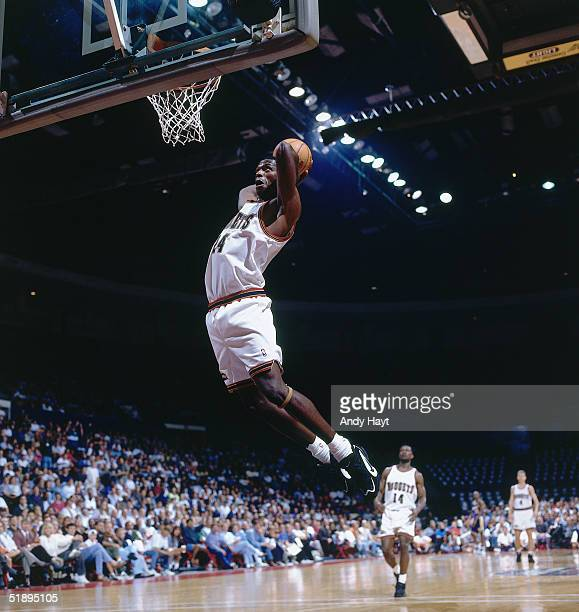 Antonio McDyess of the Denver Nuggets goes for a dunk during the NBA game in Denver Colorado NOTE TO USER User expressly acknowledges and agrees that...