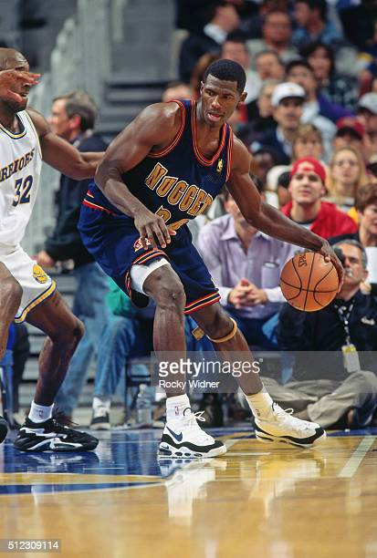 Antonio McDyess of the Denver Nuggets posts up against the Sacramento Kings circa 1997 at the Arena in Oakland in Oakland California NOTE TO USER...