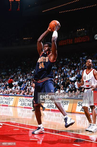 Antonio McDyess of the Denver Nuggets rebounds during the game against the Houston Rockets on January 20 2000 at Compaq Center in Houston Texas