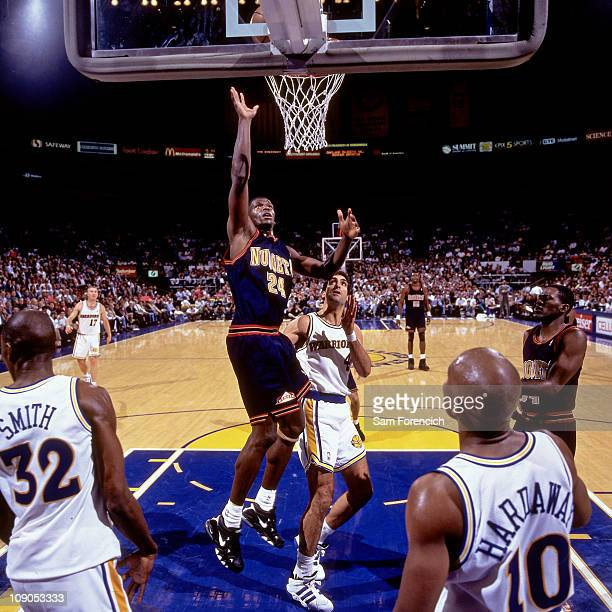 Antonio McDyess of the Denver Nuggets shoots against Rony Seikaly of the Golden State Warriors during a game in 1996 at The Oakland Coliseum in...