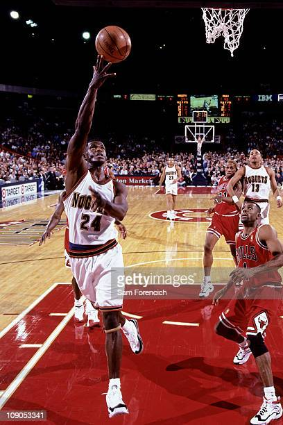 Antonio McDyess of the Denver Nuggets shoots against the Chicago Bulls in a game on November 21 1996 at The McNichols Sports Arena in Denver Colorado...