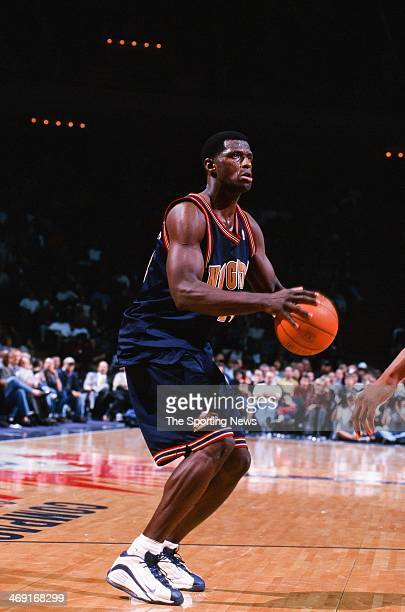 Antonio McDyess of the Denver Nuggets shoots during the game against the Houston Rockets on January 20 2000 at Compaq Center in Houston Texas