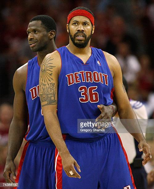 Antonio McDyess of the Detroit Pistons attempts to calm down Rasheed Wallace as Wallace was called for two technical fouls and got ejected from the...