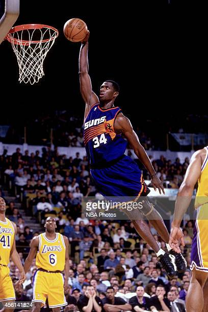 Antonio McDyess of the Phoenix Suns drives to the basket against the Los Angeles Lakers during the 1998 season at The Forum in Inglewood California...