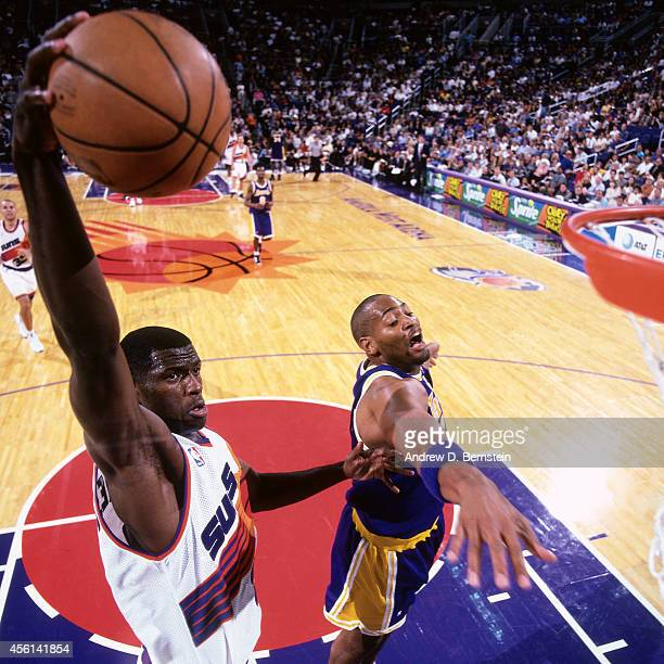 Antonio McDyess of the Phoenix Suns drives to the basket against the Los Angeles Lakers during the 1998 season at the American West Arena in Phoenix...