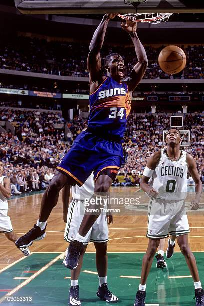 Antonio McDyess of the Phoenix Suns dunks against Walter McCarty of the Boston Celtics in a game on November 28 1997 at The Fleet Center in Boston...