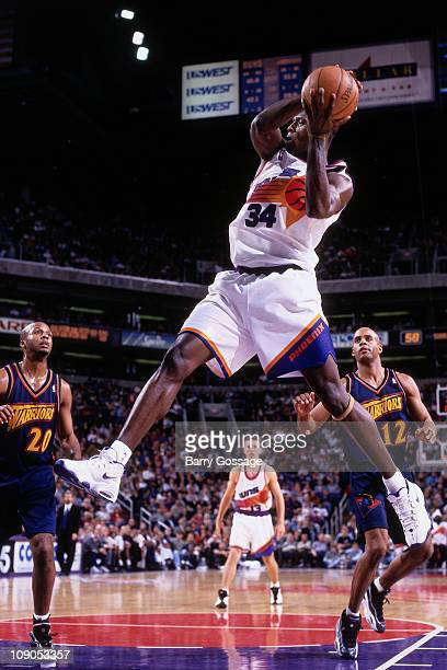 Antonio McDyess of the Phoenix Suns rebounds against the Golden State Warriors in a game on December 22 1998 at the US Airways Center in Phoenix...