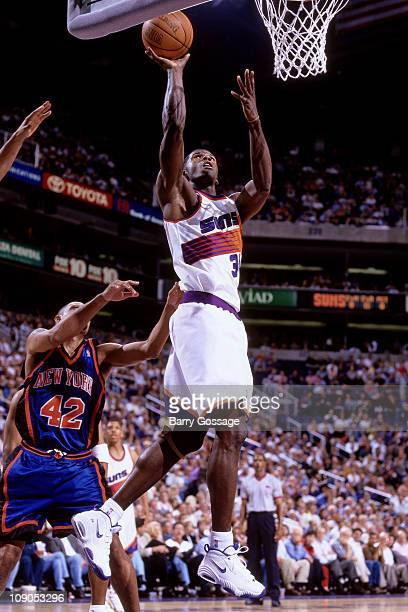 Antonio McDyess of the Phoenix Suns shoots against Chris Mills of the New York Knicks in a game on November 6 1997 at the America West Arena in...