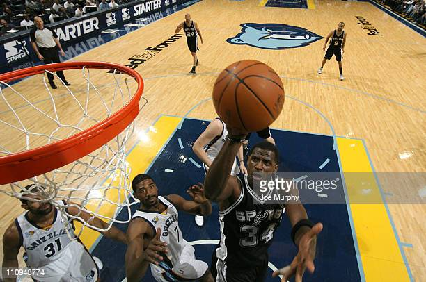 Antonio McDyess of the San Antonio Spurs shoots a layup against Leon Powe of the Memphis Grizzlies on March 27 2011 at FedExForum in Memphis...
