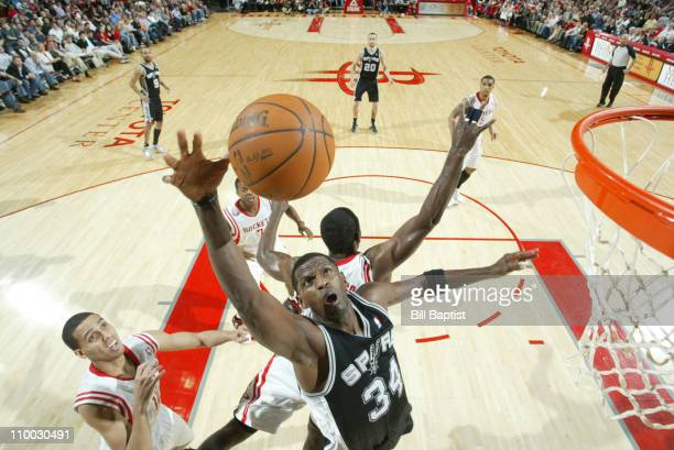 Antonio McDyess of the San Antonio Spurs shoots the ball over Kevin Martin of the Houston Rockets on March 12 2011 at the Toyota Center in Houston...