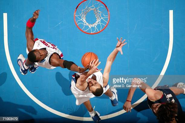 Antonio McDyess,and Tayshaun Prince of the Detroit Pistons rebound against the Cleveland Cavaliers in game seven of the Eastern Conference Semifinals...