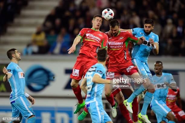 Antonio Milic defender of KV Oostende Adam Marusic midfielder of KV Oostende andSamuel Gigot defender of KAA Gent jumping towards the ball during the...