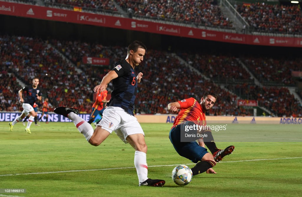 Antonio Milic of Croatia is challenged by Nacho of Spain during the UEFA Nations League A group four match between Spain and Croatia at Estadio Manuel Martinez Valero on September 11, 2018 in Elche, Spain.