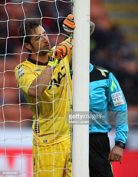 Antonio Mirante of Bologna FC repair the net during the Serie A match between AC Milan and Bologna FC at Stadio Giuseppe Meazza on January 6 2016 in...