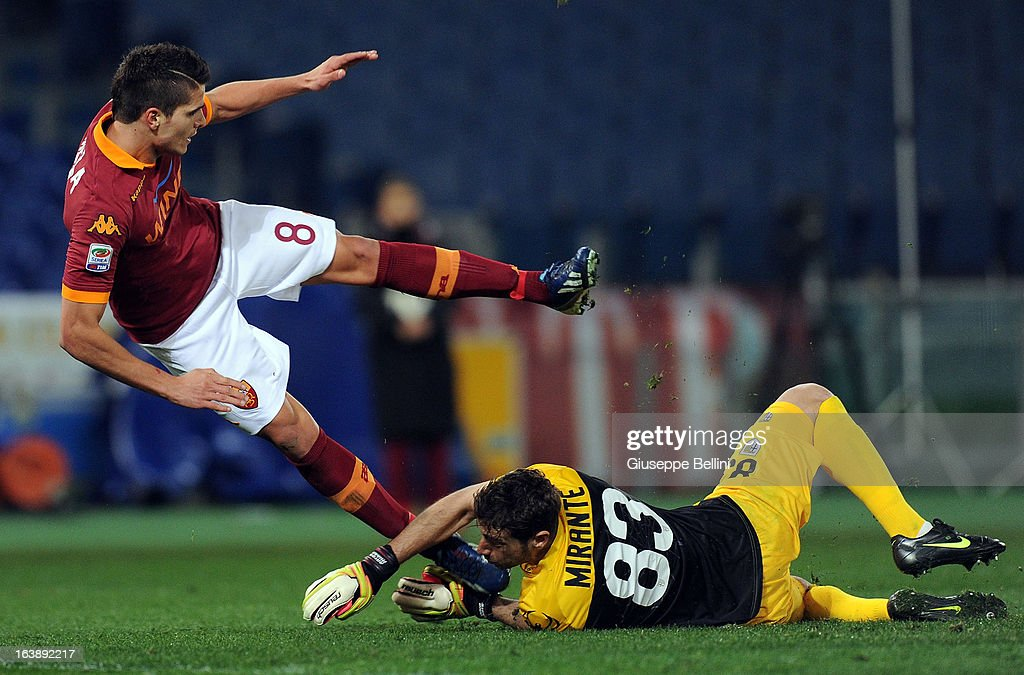 Antonio Mirante of Parma and Erik Lamela of Roma in action during the Serie A match between AS Roma and Parma FC at Stadio Olimpico on March 17, 2013 in Rome, Italy.