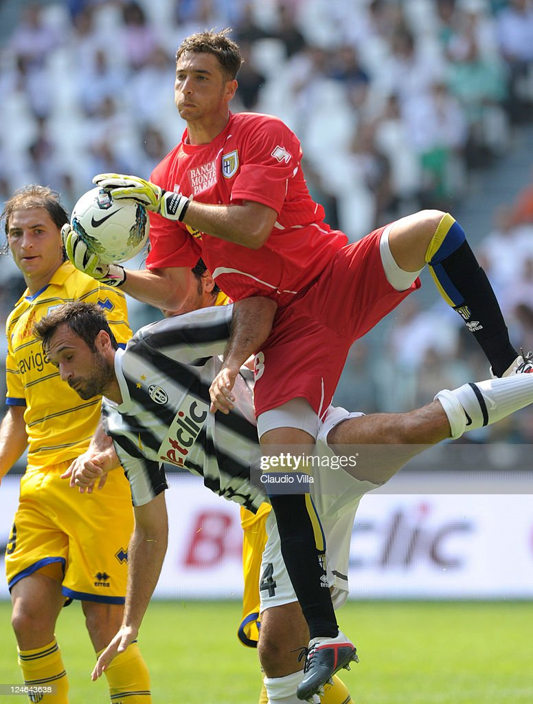 Antonio Mirante of Parma FC (R) in action against Mirko Vucinic of Juventus FC during the Serie A match between Juventus FC v Parma FC at Juventus Stadium on September 11, 2011 in Turin, Italy.