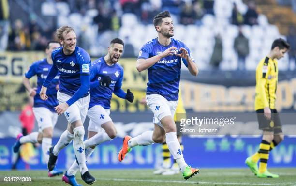 Antonio Mirko Colak of Darmstadt celebrates his team's second goal with his team mates Sidney Sam and Jan Rosenthal during the Bundesliga match...