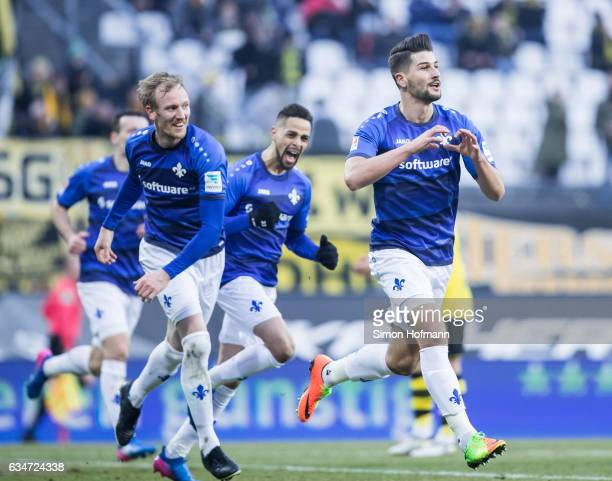 Antonio Mirko Colak of Darmstadt celebrates his team's second goal with team mates Jan Rosenthal and Sidney Sam during the Bundesliga match between...