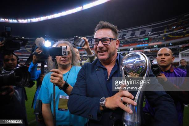 Antonio Mohamed coach of Monterrey celebrates with the Champion Trophy after the Final second leg match between America and Monterrey as part of the...