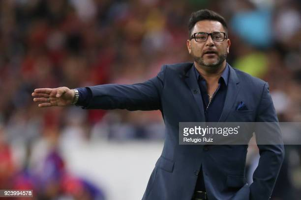 Antonio Mohamed coach of Monterrey gives instructions to his players during the 9th round match between Atlas and Monterrey as part of the Torneo...