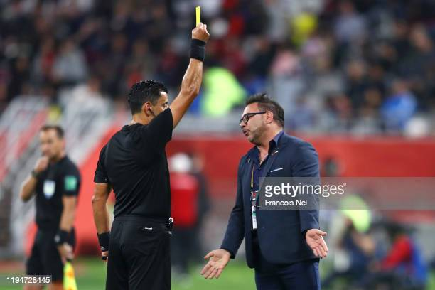 Antonio Mohamed Head Coach of CF Monterrey receives a yellow card from referee Roberto Tobar during the FIFA Club World Cup semifinal match between...
