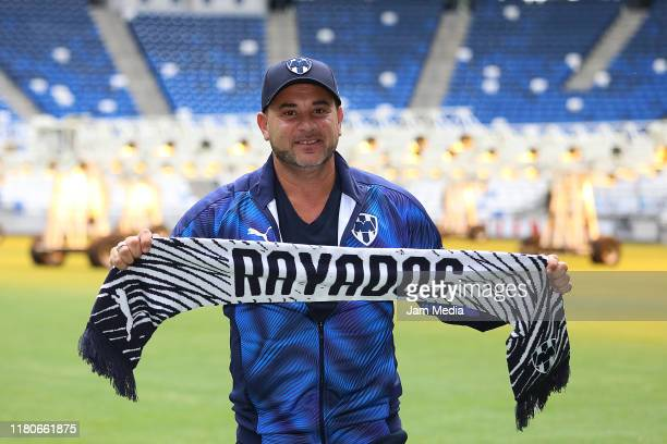 Antonio Mohamed newly appointed head coach of Monterrey poses with a Rayados scarf during the presentation of Monterrey's new head coach at Bancomer...