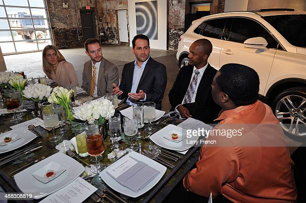 Antonio Molinari Lincoln MKC Interior Designer speaks with guests during a luncheon featuring the all new Lincoln MKC at Long View Gallery on May 5...