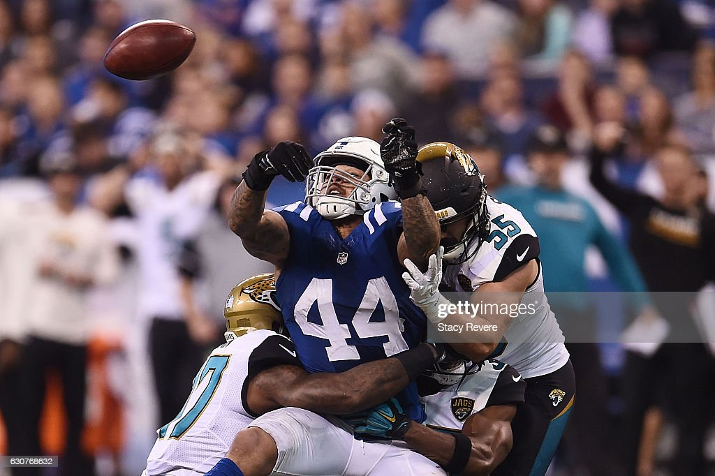 Antonio Morrison #44 of the Indianapolis Colts tries to pass the ball after a blocked punt during the second half of a game against the Jacksonville Jaguars at Lucas Oil Stadium on January 1, 2017 in Indianapolis, Indiana.