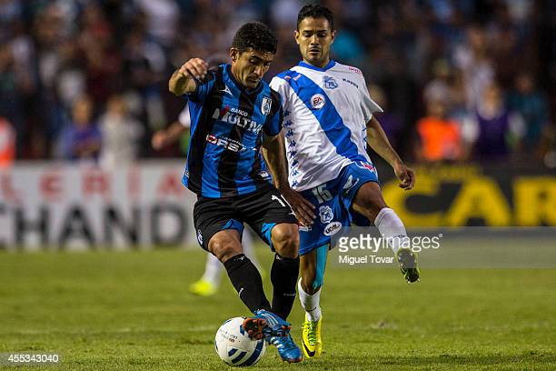 Antonio Naelson of Queretaro fights for the ball with Francisco Acu–a of Puebla during a match between Queretaro v Puebla as part of 8th round...